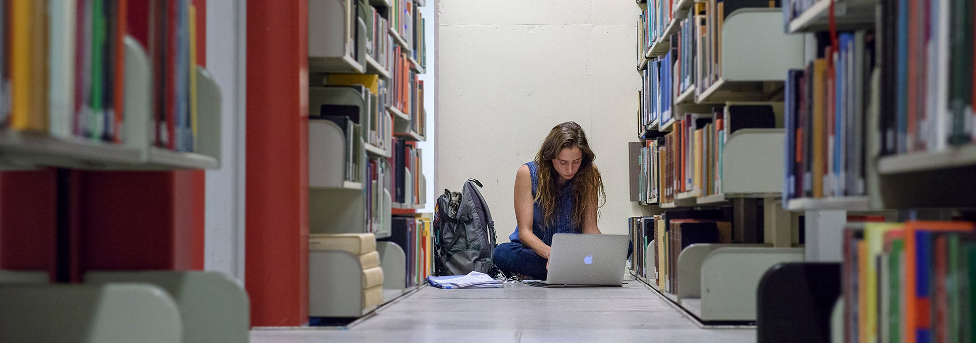 Student working on research in the Green Library