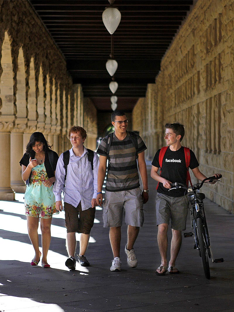 Four Stanford students walking together